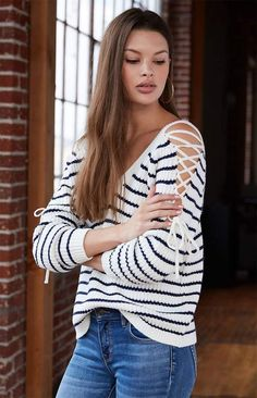 83374d6032 Stay on trend in the Lace-Up Cold Shoulder Sweater by LA Hearts. Made from  a thick knit fabric