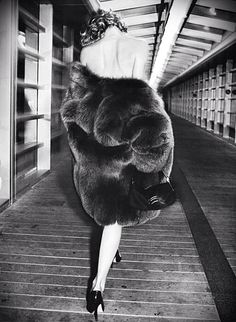 womens fashion editorial black and white photo shoot: evening look with fur coat (mw)