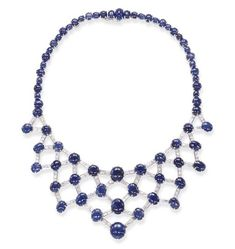 A SAPPHIRE AND DIAMOND NECKLACE  The openwork baguette-cut diamond bib of lattice motif, enhanced by cabochon sapphire accents, joined to the cabochon sapphire line necklace, mounted in white gold, 15½ ins.