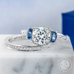 Tacori found diamond engagement ring with sapphire accents and matching wedding band, all available at Diamonds Direct. #tacori #diamond #engagementring #sapphire #septemberbirthstone #weddingband #designerengagementring #diamondsdirect