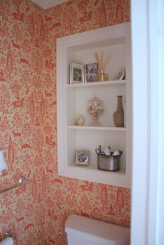 love the built in shelves, where a window was and the non-traditional wallpaper...