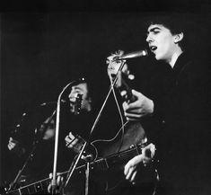 George Harrison, Paul McCartney, and John Lennon (April, 1961. The Beatles at the Top Ten Club, 136 Reeperbahn, St. Pauli, Hamburg, Germany)