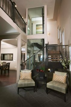 A lift in our living room taking us up to the bedroom! Definitely a must in a new home! #lift #home #elevator Calgary Home Elevators - Canwest Elevators and Lifts - Calgary Home Elevators and Lifts Channel - Homes Television