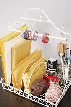 """""""I sort mailing supplies using a dish-drying rack with a dowel added for tape. Each divider fits two to three bubble envelopes, while the other half has space for twine and a jar of pens. It's such a time saver — now I don't have to rummage through drawers and closets to find what I need."""" –Kelly Rowe of Live Laugh Rowe  - GoodHousekeeping.com"""