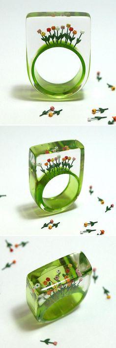 GeschmeideUnterTeck's resin ring lets you wear a garden of ten tiny tulips on your finger via etsy.