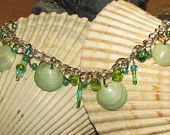 Item # 102 Shell and glass bead bracelet in greens and blues with silver chain