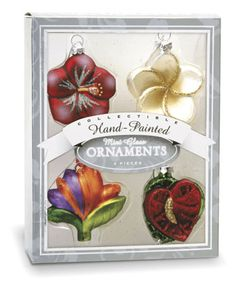 """Hand-blown and hand painted, each set includes 4 glass ornaments that measure approximately 2"""" x 2"""". Each ornament is nestled safely in an acetate blister encased in a sliver tone on tone box with a c"""