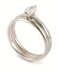 Marquise cut diamond engagement ring with matching wedding ring @ www.diamondsandrings.co.uk