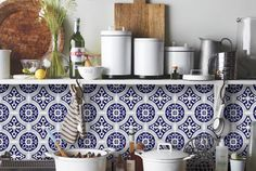 kitchen with shelf and patterned blue decals