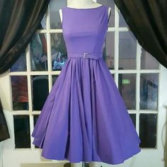 """(NEW) Inspired 50's Fit & Flare Beautiful cotton dress to reflect 50's style. It's stunning an in a gorgeous purple. I bought this dress from another posher and unfortunately it didn't me. My top is too big 36DD (36e) lol.   Bust 14 with 3"""" stretch Waist 13 with a 2.5 stretch (maybe more) Length (pit to hem) 33""""  Peticoat added for pic Dresses Midi"""