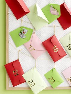 advent calendar-Made this for Jayde using white envelopes & christmas scrapbook paper for numbers.  Pretty cute.-M