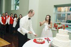 Cake cutting ceremony with red details @myweddingdotcom