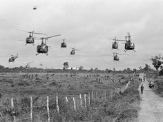 HU-1D helicopters lift from landing zone after U.S. paratroopers of the 173rd Airborne Brigade, moving toward road, were heli-lifted into area northeast of Ben Cat, 30 miles north of Saigon, South Vietnam, on Sept. 14, 1965 during the Vietnam War. American and Australian Battalions, along with South Vietnamese Battalians, are on a combined Operation in the strongest Viet Cong centers in the country.