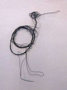 Art lesson for children - an animal or a bird made from thin wire.