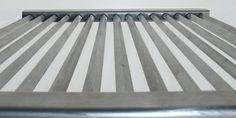 Upgrade to a premium stainless steel bbq grill today. Designed and manufactured in Australia, the unique, patented design is the key to the Topnotch grills success. By rotating the 8mm square bar 45 degrees we have reduced the contact area between the meat and the grill from 8mm in width to just 0.5mm giving you a true grilling experience. Gas Bbq, Barbecue Grill, Stainless Steel Bbq Grill, Family Bbq, Wire Brushes, Stainless Steel Material, Grills, Cast Iron, Two By Two