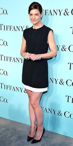 KATIE HOLMES Katie keeps it simple in a black-and-white Balenciaga mini dress and Manolo Blahnik pumps at the Tiffany & Co. Blue Book Ball in N.Y.C. The actress accessorizes with a Tiffany sapphire-and-diamond ring worth almost half a million dollars.