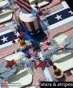 Fourth of July tablescape featuring Pier 1 Patriotic Uncle Sam Hat, Mini Rattan Star Set, striped napkins and placemats