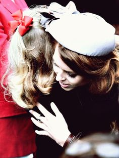 goodkingharry:  Princess Beatrice of York hugs her little cousin Lady Louise.