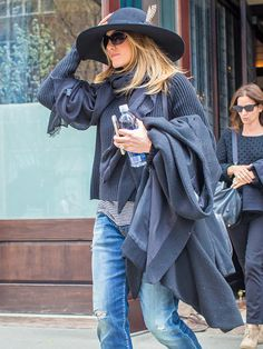 Star Tracks: Tuesday, April 28, 2015 | HOLD ON TO YOUR HAT! | Jennifer Anniston keeps her cool accessory in place on Monday while leaving her New York City hotel.