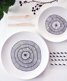 Porcelain plates with fine paint pen accents