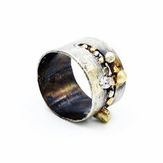 """Part of our """"Elements"""" collection ... oxidized and aged Sterling silver and 18 carat Gold cutout ring, set with silver and gold drops and a Swarovski CZ  Ring measures 1/2"""" wide  Jewelry Out Loud"""