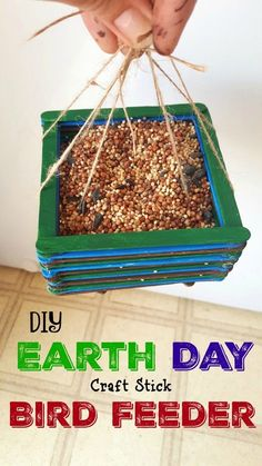 DIY Earth Day Craft Stick DIY Bird Feeder - awesome Mother's Day craft for kids too! Perfect for nature lessons and bird watching! Such a simple creative idea!