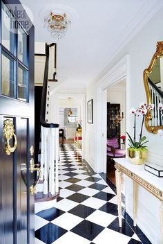 Entrance Foyer with Black and White Checkerboard Floor