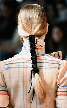 Instant ponytail upgrade: wrap with textured ribbon.