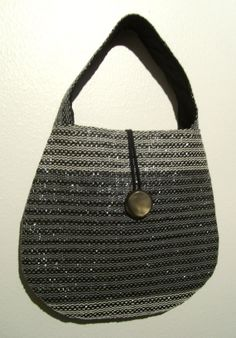 Handwoven Glossy- handbag, recycled material, video cassette tape.