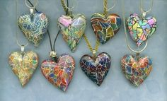 Elissa Powell used the perennial favorite, Mosaic Cane from May 2001, to make these lovely hearts. (http://www.pcpolyzine.com/may2001/mosaic.html)
