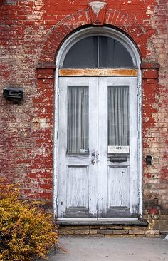 old door on brick building #door