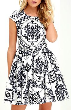 Get in touch with your inner royalty with the Royal Luxe Ivory Print Dress! An ornate display of black and lavender print covers this ivory dress, converging on a central focal point over the bodice. Princess seams and darts work flawlessly with cap sleeves and a rounded neckline to form a graceful fitted bodice on top of a skater skirt. #lovelulus