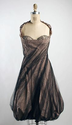 Dress  Alexander McQueen  (British, 1969–2010)    Date:      spring/summer 2007  Culture:      British  Medium:      silk  Dimensions:      Length at CB: 32 in. (81.3 cm)  Credit Line:      Purchase, Irene Lewisohn Bequest, 2007