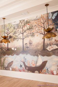 Creating an art room for my kids using this whimsical wallpaper mural. Paired perfectly with the light flooring and brass flower pendant lights.