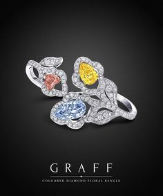 Graff Diamonds: Coloured Diamond Floral Bangle This stunning bangle is set with an exceptionally rare trilogy if diamonds - a 4.69 carat Fancy Grey Blue Pear Shape diamonds, a 3.08 carat Fancy Vivid Yellow Pear Shape diamond and a 1.53 carat Fancy Intense Orange Pink Heart Shape diamond.