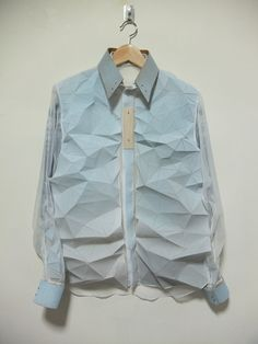 Faceted Shirt with flexible 3D fabric - innovative textiles; geometric fashion design detail; fabric manipulation // Yung Wong