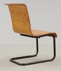 Alvar Aalto and Otto Korhonen; #23 Birch Plywood and Enameled Metal 'Karelian' Chair, 1929.