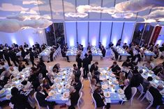 """Surrealistically Chic"" - Frost handled the lighting and created cloud-filled projections to go with the floating clouds above the dinner tables."