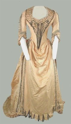 c. 1880. Two-piece ivory satin evening dress from House of Worth #victorian