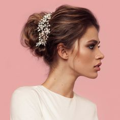 Antique gold, crystals, and cream pearls make this vintage-esqueheadpiece a stunner! Three point leaves and sweet blooms embellished with clear crystals dazzle