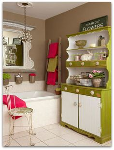 not wild about the color scheme, but like the hutch for storage and the LADDER for towels