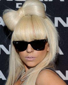 Beach blonde hair, bangs, raybans, pale pink lipstick & hair bow. Lady Gaga your my idol ;)