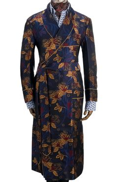 The Floral Jacquard dressing gown is made from 100% pure, 300-end silk which is woven in England.This handmade gown features patch pockets and an outbreast welt and is piped throughout in gold, which picks out the colour of the floral motif. The gown is unlined to enable the wearer to wallow in the luxurious silk cloth.Our dressing gowns are available in limited numbers and can be amended for sleeve and body length measurements, . However, if the size you require is not availabl…