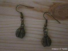 Orecchini con coccinella color bronzo