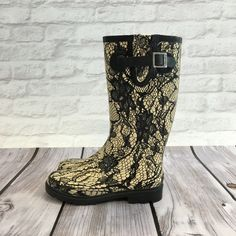 Lace Print Rain Boots Ivory colored rain boots with black lace print. Gently worn a handful of time but there is a faint pink spot on the back of the right boot that a mr clean eraser did not remove. Please carefully review each photo before purchase as they are the best descriptors of the item. My price is firm. No trades. First come, first served. Thank you! :) Chooka Shoes Winter & Rain Boots
