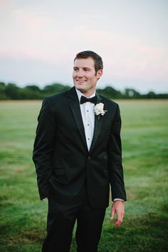 Groom looking sleek in a classic black tux: Photography: Ciro Photography - cirophotography.com   Read More on SMP: http://www.stylemepretty.com/2016/08/24/glamorous-traditional-long-island-summer-wedding/