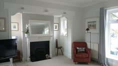 All woodwork painted in Farrow & Ball All white, fire stack in Pavilion Grey and other walls Strong White.