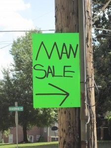 """Anyone want to buy a man today? I guess you could follow the sign and get one. Make sure you inspect him good before you part with your money... LOL.  I've seen these signs before, but they always put """"stuff"""" between the two words. They must have run out of space."""