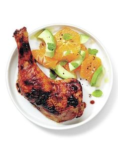 Glazed Chicken With Citrus Salad  3 tablespoons honey 1 teaspoon fresh orange juice kosher salt and black pepper 4 chicken legs (about 21/2 pounds total) 2 oranges, peeled and sliced 2 avocados, sliced 1 tablespoon olive oil 1 tablespoon red wine vinegar