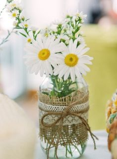 I love this shabby and sweet burlap and lace with the shasta daisies.